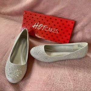 Brand new 9.5 wide Hot Cakes silver sparkly flats